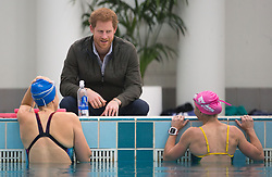 Prince Harry (centre) speaks to members of the Australian Invictus swimming squad during a visit to the Aquatic Centre at the Olympic Park Sports Centre in Sydney, Australia, which will be one of the venues for the Invictus Games Sydney 2018.