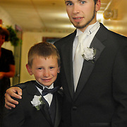 Matt Hawkes poses with his son on his wedding day to Elizabeth Wildrick at The Fireside inn in Auburn, ME.  Photo by Roger S. Duncan.