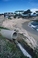Urban land runoff drains into the ocean.