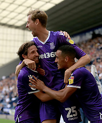 Stoke City's Peter Crouch (centre) celebrates with team-mates Joe Allen (left) and Tom Ince after he scores his sides second goal of the game