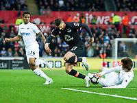Football - 2016 / 2017 Premier League - Swansea City vs. Everton<br /> <br /> Kevin Mirallas tackled by Ki Sung-Yueng of Swansea , at Liberty Stadium.<br /> <br /> COLORSPORT/WINSTON BYNORTH