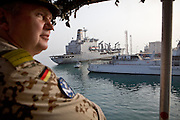 "Frigate Captain Nils Brandt returns to Djibouti harbour, passing French and US Army boats, after an operation carried out by the German navy...German Navy Force working with Operation Atalanta (EU anti-piracy mission) and OEF (Operation Enduring Freedom) on sea reconnaissance mission using a battleship called ""Schleswig-Holstein"", to identify potential piracy activities off the coast of Somalia...The geostrategical and geopolitical importance of the Republic of Djibouti, located on the Horn of Africa, by the Red Sea and the Gulf of Aden, and bordered by Eritrea, Ethiopia and Somalia."