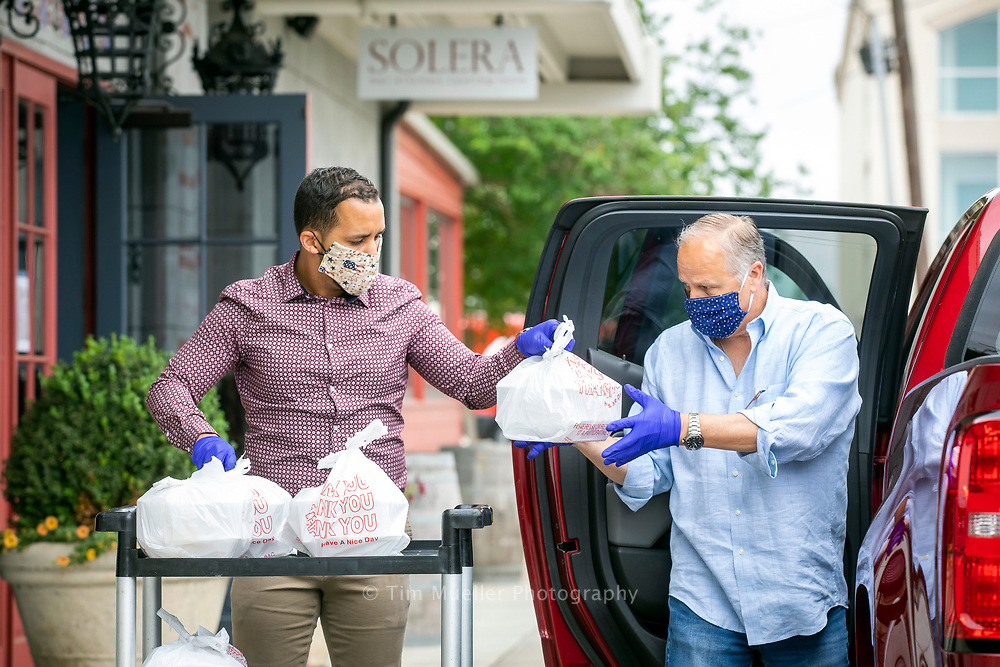 Solera General Manager David Jimenez, left, and owner Brian Dykes load 75 lunches form the restaurant Tuesday, April 14, 2020 for the Better Together Meal program. The meals will be delivered to frontline pandemic healthcare workers at Baton Rouge General Mid-City. The Baton Rouge Area Foundation with Entergy, Blue Cross Blue Shield of Louisiana Foundation, ExxonMobil, Humana, LMOGA is managing a charitable fund to help support restaurants and feed health care workers during the coronavirus pandemic.