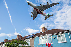 """London, UK. 17 June, 2019. An aircraft on the final approach to Heathrow airport passes over houses in Hounslow. On 18th June, Heathrow will publish its airspace and future operations consultation on its """"master plan"""" for Heathrow expansion following approval in principle of a third runway by MPs last year. Heathrow is expected to increase the number of flights from the current cap of 480,000 per year imposed when Terminal 5 was built to 505,000 per year in 2021 and to 740,000 per year should a third runway be constructed."""