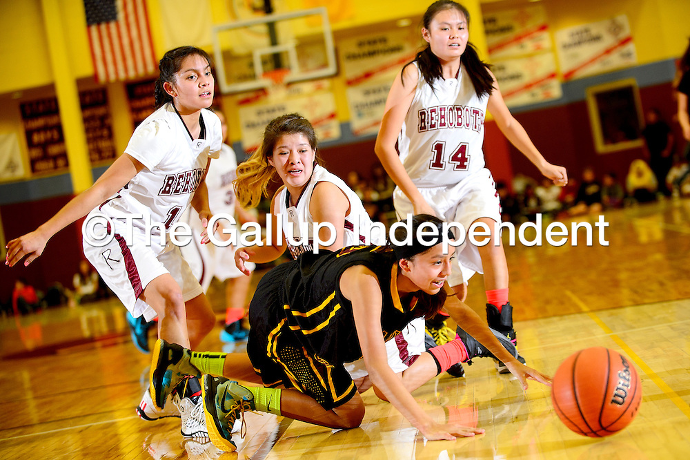 020714  Adron Gardner/Independent<br /> <br /> Tohatchi Cougar Kalian Mitchell (5), center, reaches for a loose ball ahead of  the Rehoboth Lynx in Rehoboth Friday.