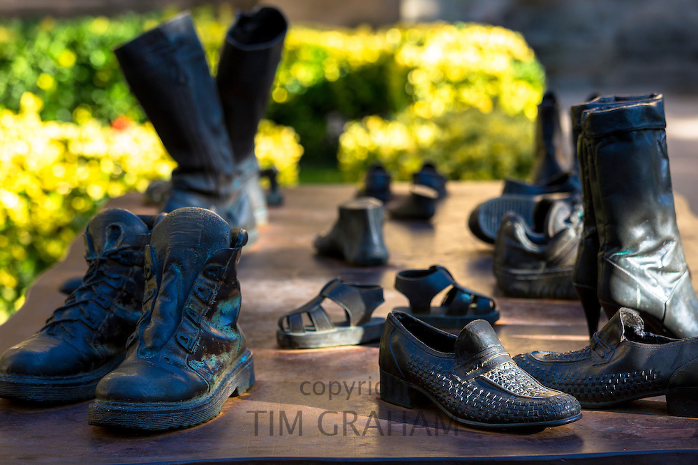 "Bronze table-top sculptures of footwear by Koko Rico titled ""Viajeros/Bidaiariak Izenekoa"" at Laguardia in Rioja-Alavesa, Spain"