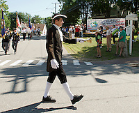 """Geoff Ruggles rings the """"Town Crier"""" bell during the Gilford Bicentennial parade Saturday morning.   (Karen Bobotas/for the Laconia Daily Sun)"""