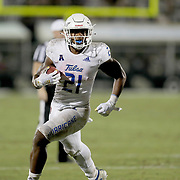 ORLANDO, FL - OCTOBER 03:  T.K. Wilkerson #21 of the Tulsa Golden Hurricane breaks away against the Central Florida Knights at Bright House Networks Stadium on October 3, 2020 in Orlando, Florida. (Photo by Alex Menendez/Getty Images) *** Local Caption *** T.K. Wilkerson