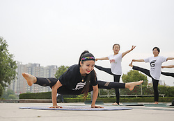 June 18, 2018 - Tengzh, Tengzh, China - Tengzhou, CHINA-18th June 2018: Women practice yoga in Tengzhou, east China's Shandong Province, marking the upcoming International Yoga Day which falls on June 21st every year. (Credit Image: © SIPA Asia via ZUMA Wire)