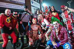 © Licensed to London News Pictures . 26/12/2018. Wigan, UK. People pay tribute to Stan Lee with multiple costumes based on his characters . Revellers in Wigan enjoy Boxing Day drinks and clubbing in Wigan Wallgate . In recent years a tradition has been established in which people go out wearing fancy-dress costumes on Boxing Day night . Photo credit: Joel Goodman/LNP