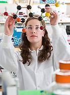 Dyax researcher Shauna Mason studying a molecular model in the lab