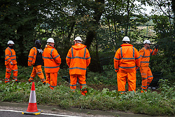 Wendover, UK. 10th October, 2021. Enforcement agents from the National Eviction Team (NET) commence works to evict environmental activists opposed to the HS2 high-speed rail link from Wendover Active Resistance (WAR) camp. WAR camp, which contains tree houses, tunnels, a cage and a 15-metre tower, is currently the largest of the protest camps set up by Stop HS2 activists along HS2's Phase 1 route between London and Birmingham.