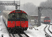 © Licensed to London News Pictures. 18/01/2013. London, UK Piccadilly Line tube trains in the snow. Snow in West London today 18th January 2013. Photo credit : Stephen Simpson/LNP