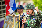 "04 AUGUST 2013 - BANGKOK, THAILAND: Capt SONGLOD CHUENCHOOPOL, (Retired) of the Royal Thai Army, makes an anti-government speech during the anti-government rally in Bangkok Sunday. Capt. Songlod used to be a ""Red Shirt"" supporter of Thaksin Shinawatra but recently switched sides to be a Thaksin opponent. About 2,000 people, members of the  People's Army against Thaksin Regime, a new anti-government group, protested in Lumpini Park in central Bangkok. The protest was peaceful but more militant protests are expected later in the week when the Parliament is expected to debate an amnesty bill which could allow Thaksin Shinawatra, the exiled former Prime Minister, to return to Thailand.     PHOTO BY JACK KURTZ"