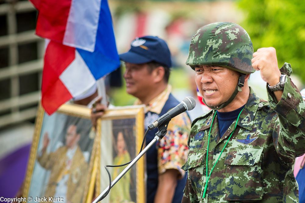 """04 AUGUST 2013 - BANGKOK, THAILAND: Capt SONGLOD CHUENCHOOPOL, (Retired) of the Royal Thai Army, makes an anti-government speech during the anti-government rally in Bangkok Sunday. Capt. Songlod used to be a """"Red Shirt"""" supporter of Thaksin Shinawatra but recently switched sides to be a Thaksin opponent. About 2,000 people, members of the  People's Army against Thaksin Regime, a new anti-government group, protested in Lumpini Park in central Bangkok. The protest was peaceful but more militant protests are expected later in the week when the Parliament is expected to debate an amnesty bill which could allow Thaksin Shinawatra, the exiled former Prime Minister, to return to Thailand.     PHOTO BY JACK KURTZ"""