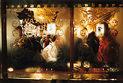 London pub window.Looking through an ornately traditional English pub window, an unidentified drinker reaches for their pint of beer, as seen through the front frosted window of a tradtional pub in Drury Lane, in London's West End..From the 'Windows' series.