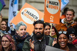 © Licensed to London News Pictures. 08/03/2020. LONDON, UK. Himesh Patel (C), actor and star of the movie Yesterday, joins thousands of people in the annual March 4 Women on International Women's Day. The event this year celebrates the power and passion of women and girls who are on the frontline of responding to climate change.  The walk through central London from Whitehall Place ends with a rally in Parliament Square.  Photo credit: Stephen Chung/LNP