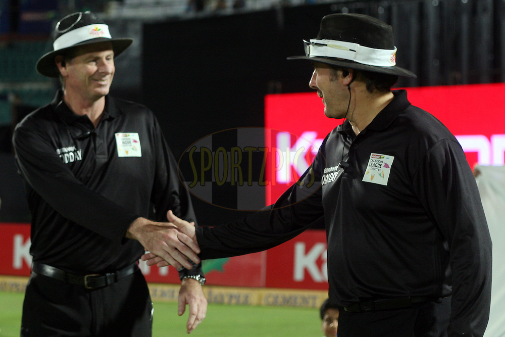 Umpires Richard Illingworth (England) and Paul Reiffel (Australia) walking out onto the field during match 18 of the Karbonn Smart Champions League T20 (CLT20) 2013  between The Rajasthan Royals and the Otago Volts held at the Sawai Mansingh Stadium in Jaipur on the 1st October 2013. Photo by Jacques Rossouw-CLT20-SPORTZPICS <br /> <br /> Use of this image is subject to the terms and conditions as outlined by the CLT20. These terms can be found by following this link:<br /> <br /> http://sportzpics.photoshelter.com/image/I0000NmDchxxGVv4