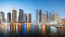 Skyline of skyscrapers  at night in  Marina district of Dubai United Arab Emirates
