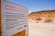 July 12 - GILA BEND, AZ: Signs warning recreational users of the Sonoran Desert National Monument of the dangers of encountering illegal immigrants and drug smugglers on Freeman Rd, south of Gila Bend, AZ, off of Interstate 8. The Bureau of Land Management (BLM) put up the signs at entrances to the Sonoran Desert National Monument after off roaders reported being shot at by unknown parties and a deputy from the Pinal County Sheriff's Department was fired on and nearly killed by suspected drug dealers. The signs have ignited a firestorm in Arizona politics, conservatives and anti-immigration activists assert that the signs are proof that illegal immigration and drug smuggling is out of control in the area while others suggest that the danger is overstated and the signs are hurting Arizona tourism. A BLM spokesperson said no one has been hurt in the area by confirmed smugglers and that there are very few encounters between smugglers and tourists or off roaders in the monument. Photo by Jack Kurtz