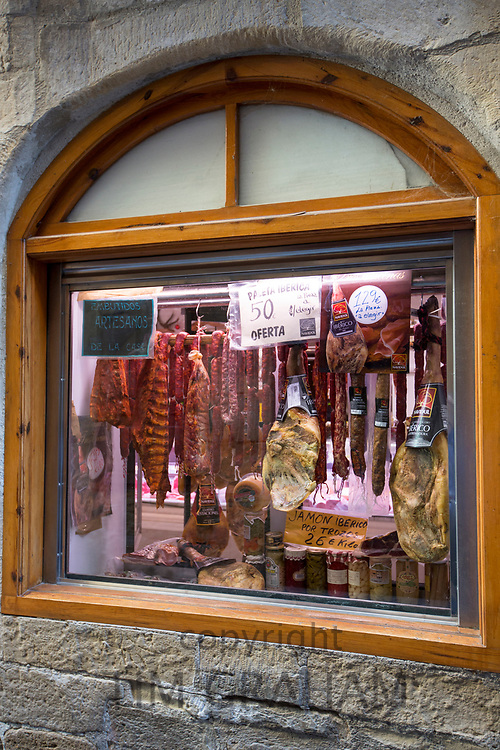 Jamon Iberico, famous Iberico ham cured meat in food shop in Calle Mayor in town of Laguardia, Rioja-Alavesa, Basque country, Spain