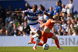 QPR's midfielder Karl Henry and Blackpool's defender Gary MacKenzie compete for the ball - Photo mandatory by-line: Mitchell Gunn/JMP - Tel: Mobile: 07966 386802 29/03/2014 - SPORT - FOOTBALL - Loftus Road - London - Queens Park Rangers v Blackpool - Championship