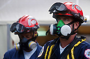 """NEW YORK, NY: Recovery workers wearing a breathing filters at """"Ground Zero"""" of the World Trade Center complex after the WTC terrorist attack, Sept. 22, 2001. Almost 3,000 people were killed when terrorists crashed hijacked passenger jets into the twin towers. PHOTO BY JACK KURTZ"""