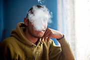 Rudo (25) smoking in one of the families selfconstructed houses in Rankovce. After one year of contruction (04/2014) the family is already able to life in the building.  The foundation ETP Slovakia has a project setting up micro-loan funds for the local Roma community. Loans from this fund will enable families to build their own low-cost brick homes, on land they own.