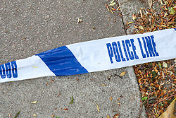 © Licensed to London News Pictures. 30/04/2019. London, UK. Leftover police tape in Muswell Hill Broadway, Haringey, north London where a 18 yeary old man was found suffering from knife wounds shortly after 9.20pm on Monday 29 April 2019. The victim was treated at the scene before being rushed to hospital. Photo credit: Dinendra Haria/LNP