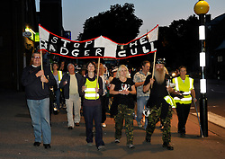 © Licensed to London News Pictures. 26/08/2013. Minehead, Somerset, UK. People protesting against the planned badger cull gather hold a candlelit vigil and march in the town of Minehead in West Somerset which is one of the areas where badgers will be shot by marksmen in a pilot trial with the eventual aim of reducing bovine turberculosis in cattle.  28 August 2013.<br /> Photo credit : Simon Chapman/LNP