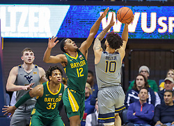 Mar 7, 2020; Morgantown, West Virginia, USA; Baylor Bears guard Jared Butler (12) defends West Virginia Mountaineers guard Jermaine Haley (10) during the first half at WVU Coliseum. Mandatory Credit: Ben Queen-USA TODAY Sports