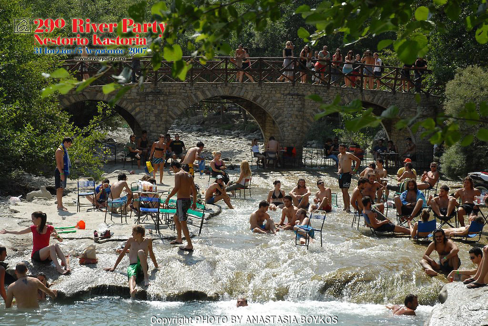 The river full of people getting cooler under the hot sun!