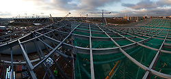 Aquatics Centre. View of construction of the distinctive roof of the Aquatics Centre. The Olympic Stadium (left) and Olympic Village (right) are visible in the distance. Picture taken on 09 Nov 09 by David Poultney.