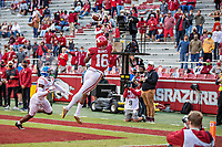 FAYETTEVILLE, AR - OCTOBER 17:    Treylon Burks #16 of the Arkansas Razorbacks catches a touchdown pass with one foot in against A.J. Finley #21 of the Mississippi Rebels at Razorback Stadium on October 17, 2020 in Fayetteville, Arkansas.  The Razorbacks defeated the Rebels 33-21.  (Photo by Wesley Hitt/Getty Images) *** Local Caption *** Treylon Burks; A.J. Finley