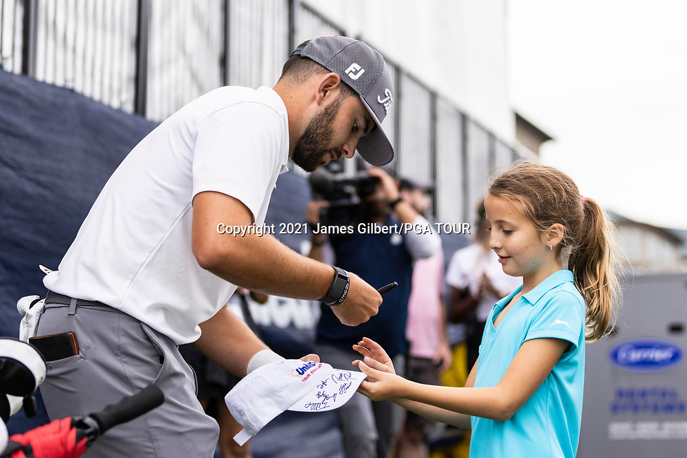 NEWBURGH, IN - SEPTEMBER 04: Hayden Buckley signs an autograph for a young fan on the 18th green after the third round of the Korn Ferry Tour Championship presented by United Leasing and Financing at Victoria National Golf Club on September 4, 2021 in Newburgh, Indiana. (Photo by James Gilbert/PGA TOUR via Getty Images)
