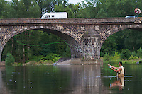 Alain Luzuy fly-fishing in the river Allier upstream of the old  stone bridge of Pont-du-Chateau, Auvergne, France.