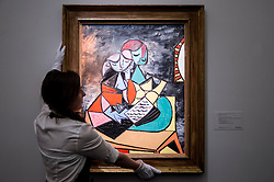 """© Licensed to London News Pictures. 19/06/2015. London, UK. A Sotheby's staff member shows Pablo Picasso's """"Deux Personnages (La Lecture)"""" (est. £13m - £18m), at Sotheby's Impressionist, Modern & Contemporary Art preview, ahead of the sale on 24 June 2015. Leading the sale are Kazimir Malevich's, """"Suprematism, 18th Construction"""" and Edouard Manet's """"Le Bar aux Folies-Bergère"""".  Photo credit : Stephen Chung/LNP"""
