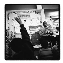 2/19/03 Boris Henderson (rt), a Wachovia employee, reads to Patricia Dowdy's Double Oaks Pre-Kindergarten class. Henderson, who once lived near the Double Oaks neighborhood, is part of the bank's volunteer program.  L.MUELLER/staff photo