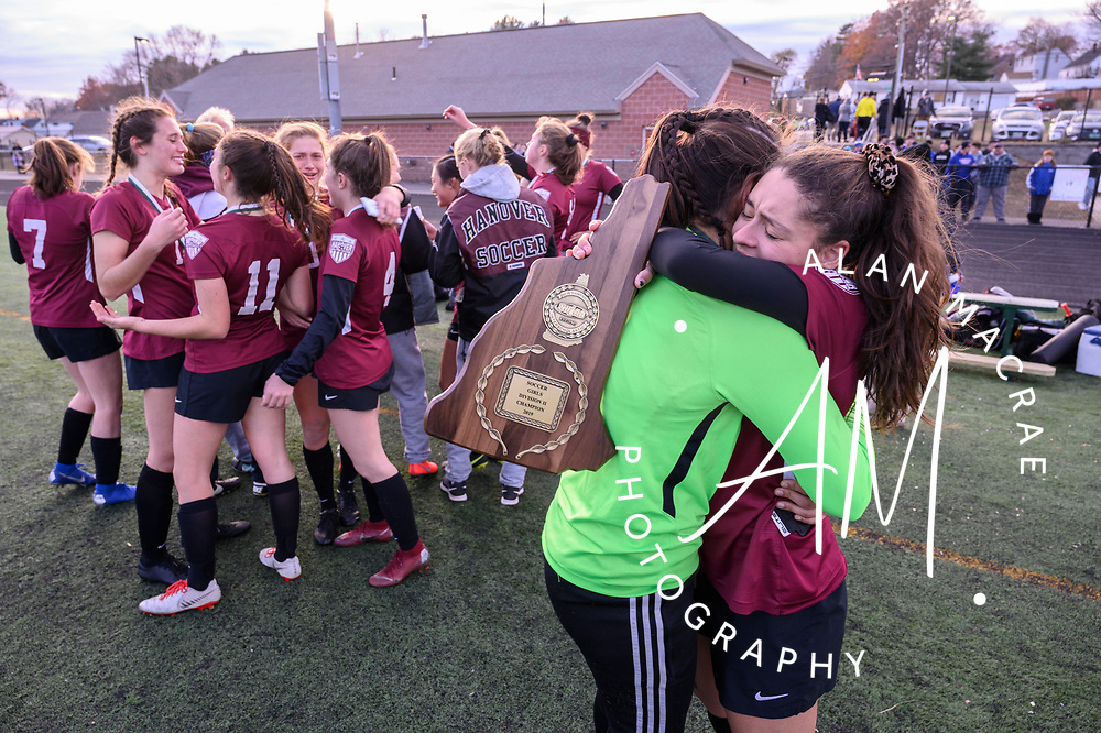 Hanover girls celebrate their NHIAA Division II championship win at Manchester's Memorial High School on Sunday, November 10, 2019.  (Alan MacRae/Valley News)