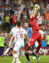 SOCHI, June 30, 2018  Goalkeeper Fernando Muslera (1st R) of Uruguay saves the ball during the 2018 FIFA World Cup round of 16 match between Uruguay and Portugal in Sochi, Russia, on June 30, 2018. Uruguay won 2-1 and advanced to the quarter-final. (Credit Image: © Liu Dawei/Xinhua via ZUMA Wire)