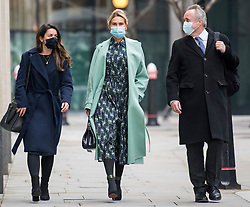 © Licensed to London News Pictures. 07/12/2020. London, UK. TATIANA AKHMEDOV (centre) arrives at The High Court in London. Tatiana Akhmedova, who is locked in a multi-million pound divorce settlement battle with her ex husband, Russian billionaire Farkhad Akhmedov, claims her son, Temur, helped his father to hide assets. Photo credit: Ben Cawthra/LNP