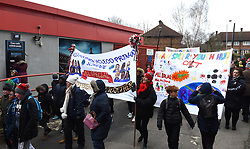 Red, white and black day procession on route to the Valley from Charlton Station
