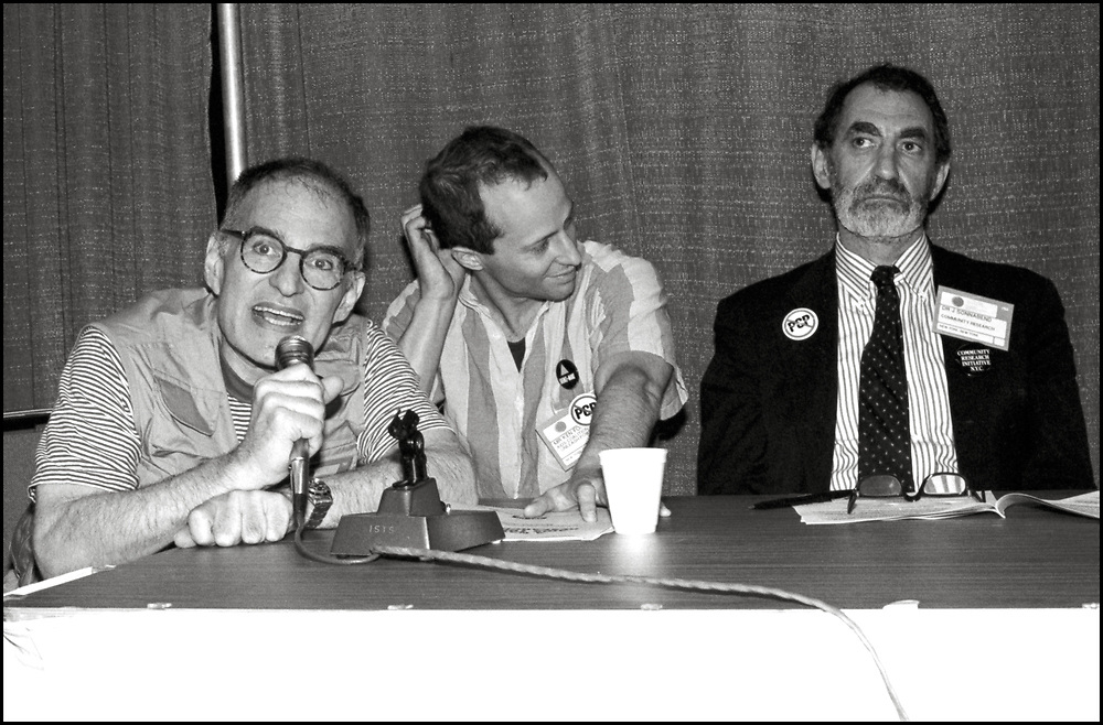 Larry Kramer and Ken Fornataro of ACT UP, and Joseph Sonnabend, an Afrikaans physician, speaking on a panel about the possible Antiviral drugs that could be used to combat HIV/AIDS at the Fifth International AIDS Conference in Montreal.