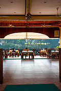 Looking through an open plan restaurant, morning, Luang Prabang, Laos.