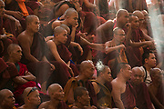 Monks in audience at Kick boxing at festival, Win Sein Taw Yaw Reclining Buddha, Mudon, Mawlamyine, Myanmar