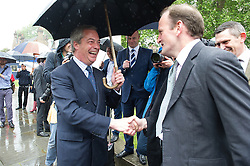 © London News Pictures. 18/05/15. London, UK. Nigel Farage, leader of the UKIP party, greets Douglas Carswell UKIP MP, before they sign a petition for electoral reform, Westminster, Central London. Photo credit: Laura Lean/LNP/05/15.