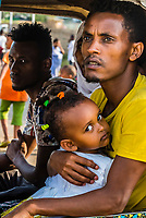 Father and daughter riding in a tuk tuk, Arba Minch, Southern Nations Nationalities and People's Region, Ethiopia.