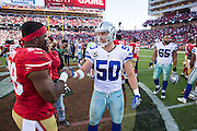 San Francisco 49ers running back Carlos Hyde (28) talks with Dallas Cowboys outside linebacker Sean Lee (50) after the game at Levis Stadium in Santa Clara, Calif., on October 2, 2016. (Stan Olszewski/Special to S.F. Examiner)