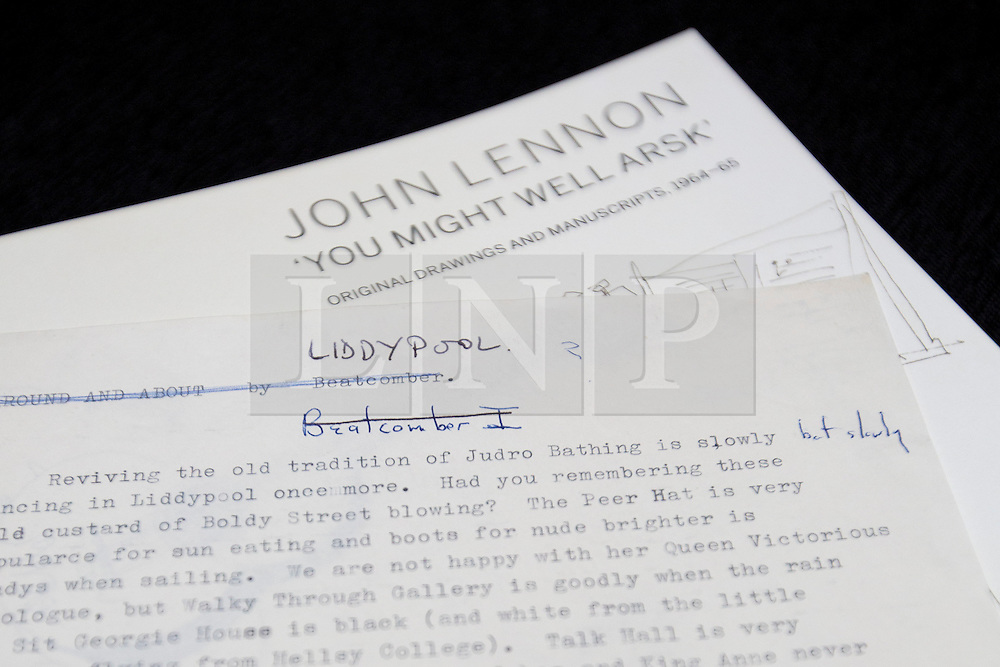 """© Licensed to London News Pictures. 21/03/2014. London, UK. """"Liddypool"""" (est. GB£7,200-9,000) a sartorial guide to Liverpool typed by the late Beetles singer John Lennon, is seen during the press view for a new sale at Sotheby's auction house in London today (21/03/2014). The auction, entitled """"You Might Well Arsk"""", features original drawings and manuscripts by the singer from 1964-1965. Photo credit: Matt Cetti-Roberts/LNP"""