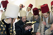 During the Jewish festival of Purim a group of Orthodox Jewish boys from the Viznitz Yeshiva (school) in fancy dress visit local businessmen to collect money for their school. Some of the businessman that they visit read a prayer to the group. The young boys drink alcohol at every house they visit during the day.